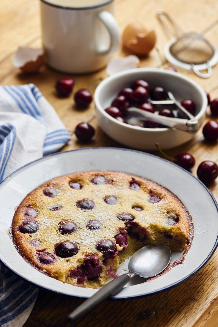 Cherry clafoutis on a rustic wooden table