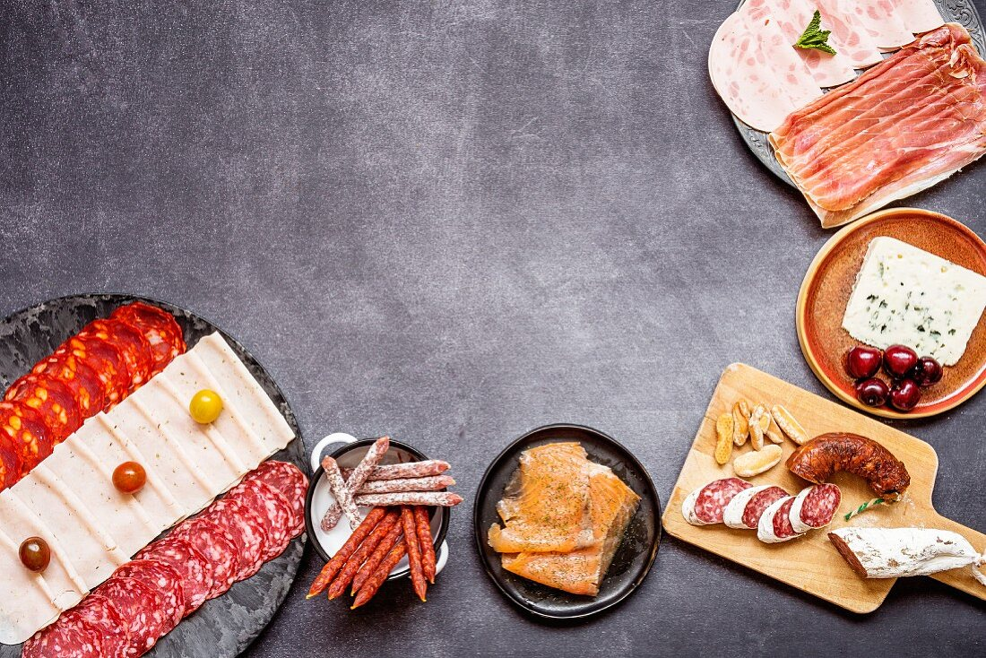 Various sausages, cheese, and smoked salmon in a Spanish kitchen