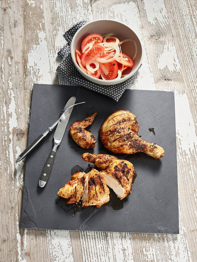 Piri piri chicken with tomato and onion salad