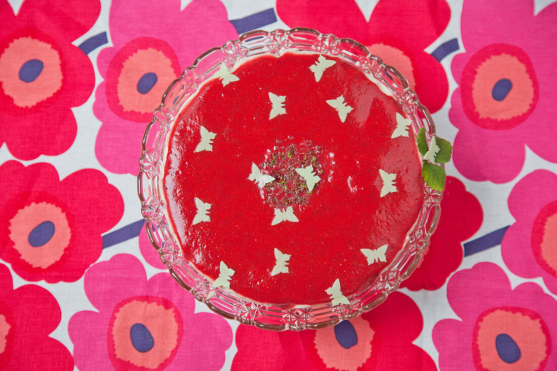 Cake decorate with butterflies on floral tablecloth