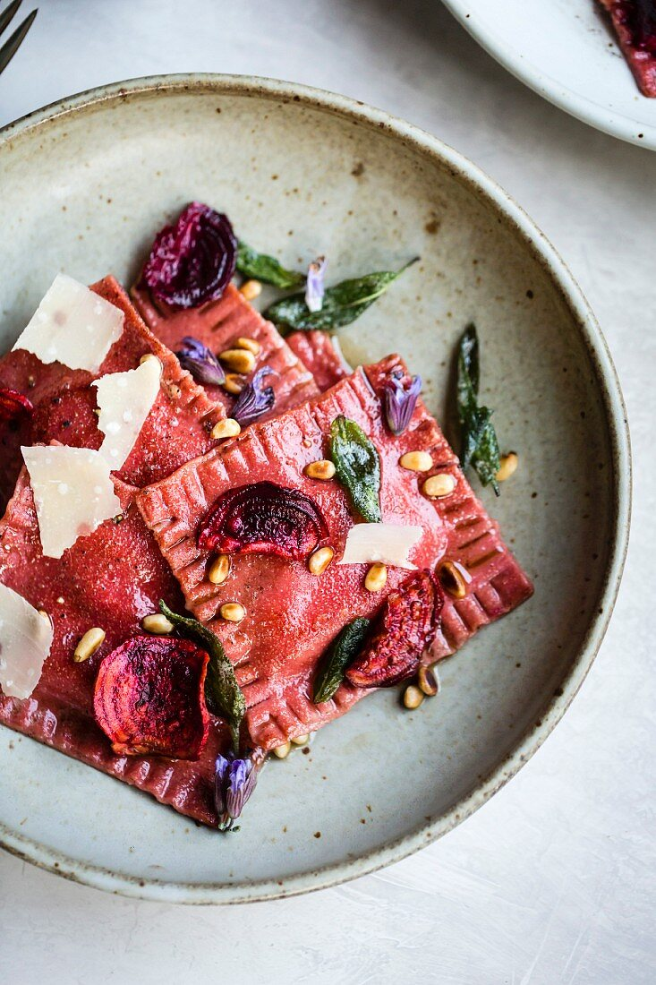 Vegetarian beetroot ravioli with pine nuts and Parmesan