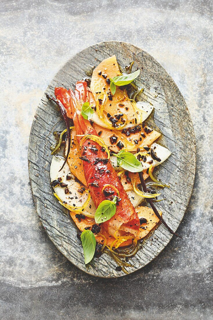 Melon carpaccio with a king prawn and lemon, olive and vanilla dressing