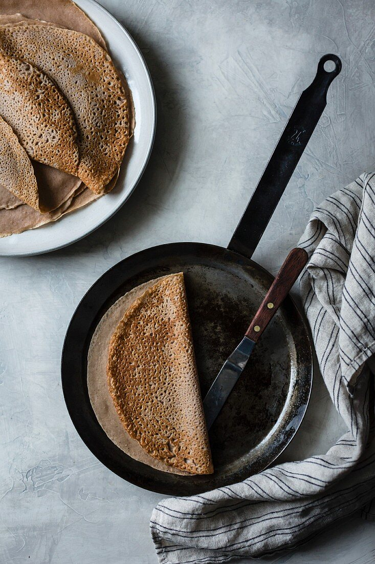 Blintzes being cooked in a pan
