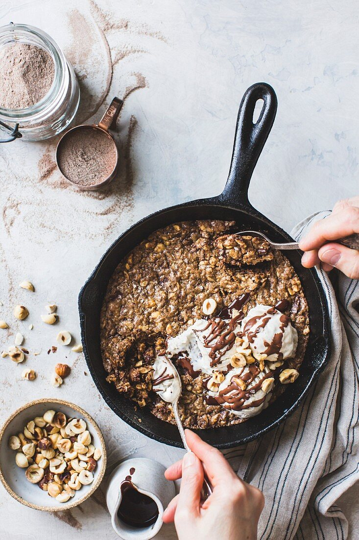 Teff skillet blondie with ice cream and chocolate drizzle