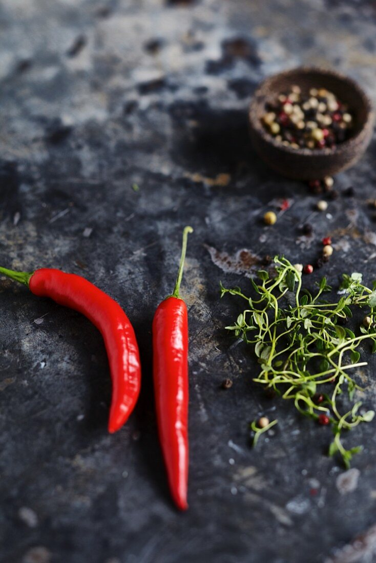 Red chili peppers, peppercorns, and herbs