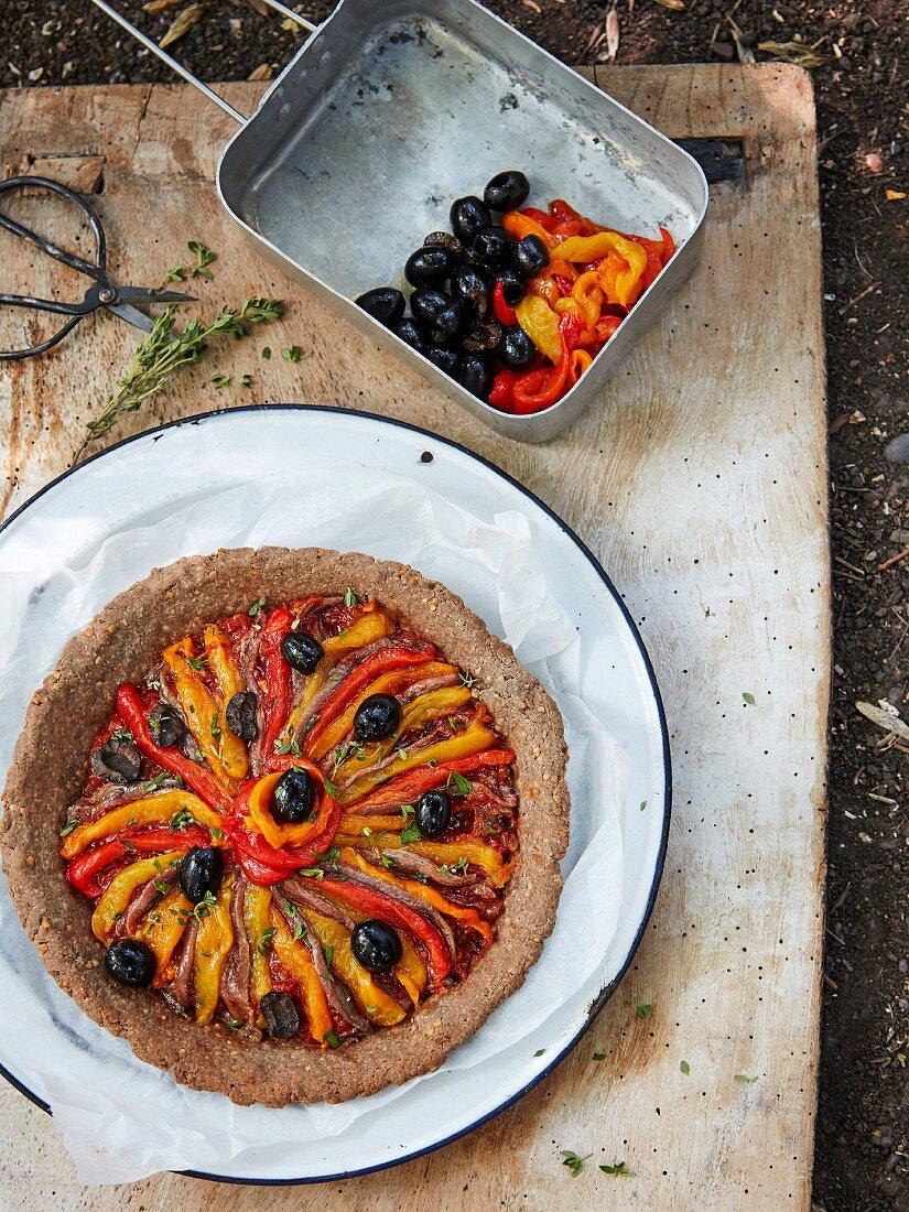 Roasted pepper and olive tart with anchovies