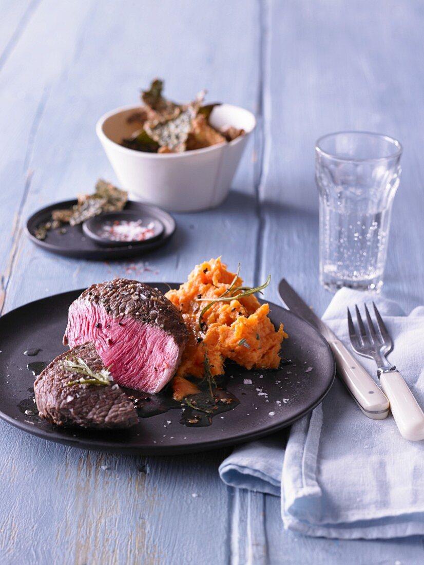 Steak with sweet potato mash and cabbage crisps