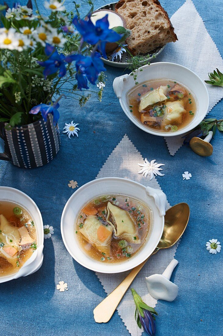 Chanterelle and pasta soup with chives