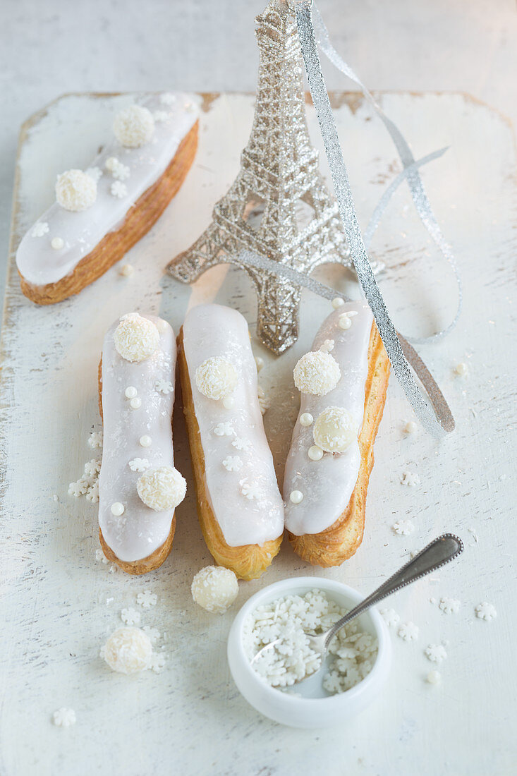 Eclairs and a silver Eiffel Tower model for Christmas