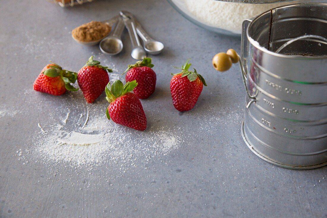 Baking ingredients: strawberries, flour and cinnamon