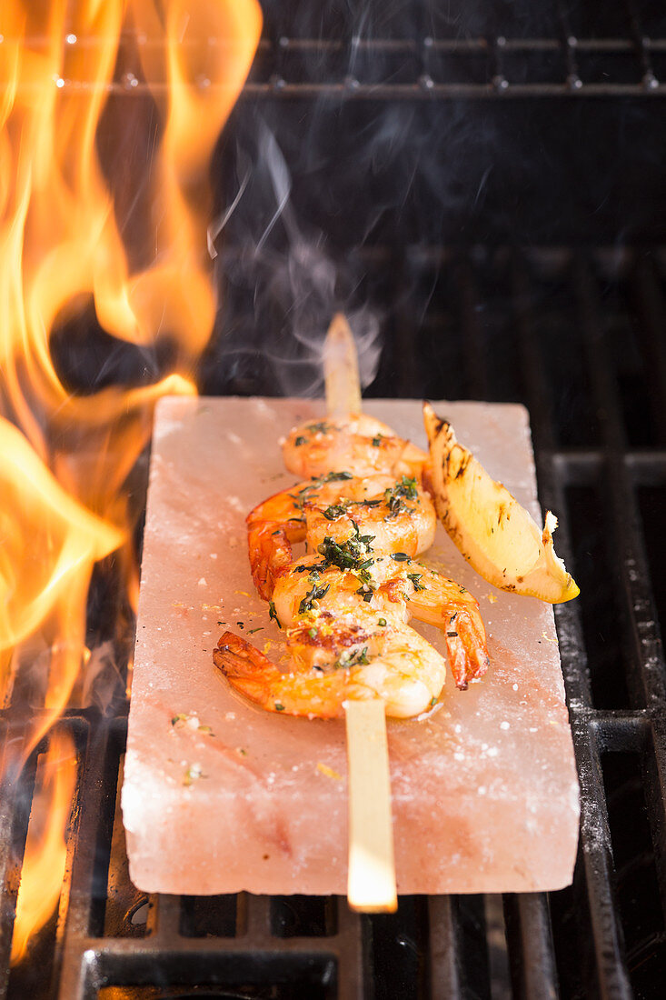 Shrimps being grilled on a salt slab