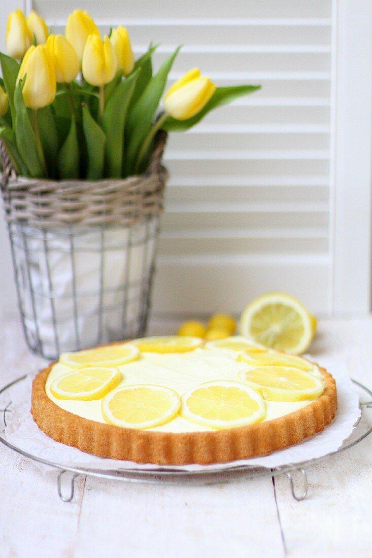 Lemon cream tart and yellow tulips