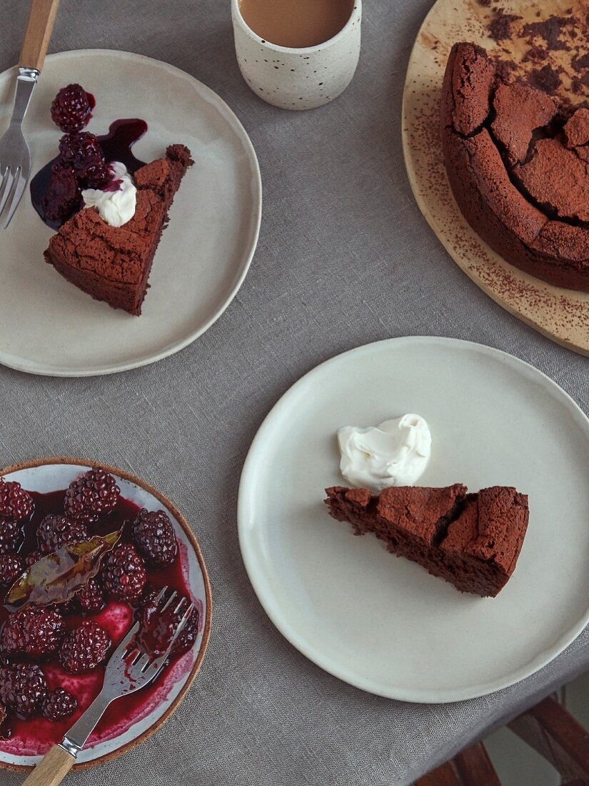 Flourless chocolate cake with wine-roasted winter blackberries with bayleaf