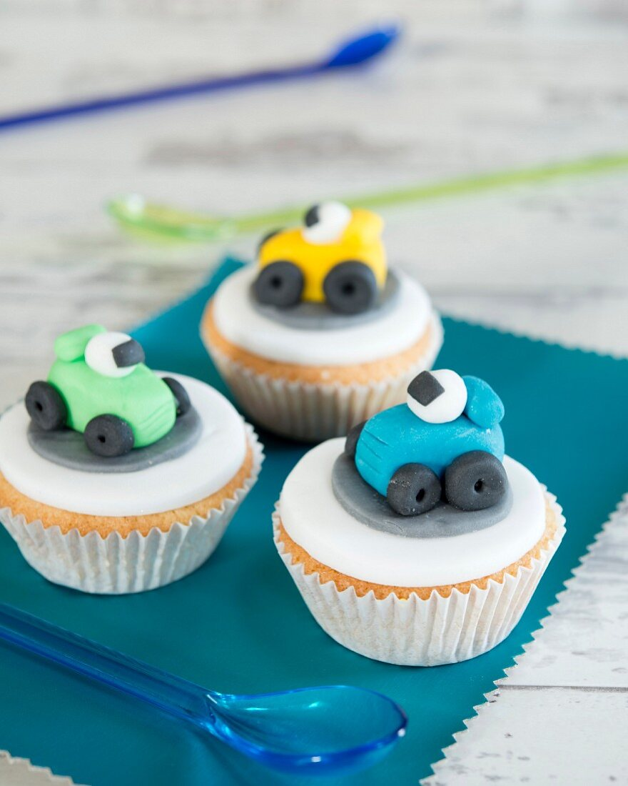 Cupcakes for a children's party decorated with fondant cars