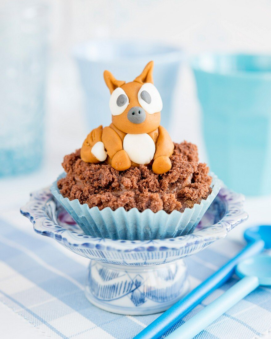 A cupcake with a fondant dog