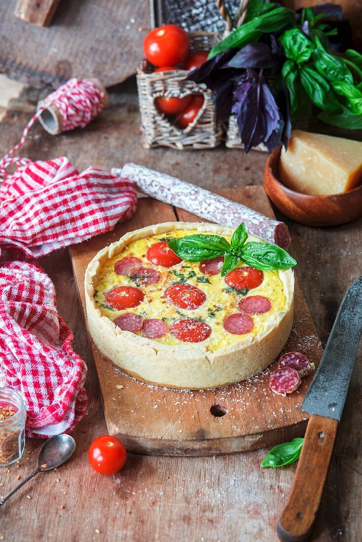 Cheese pie with tomatoes and salami
