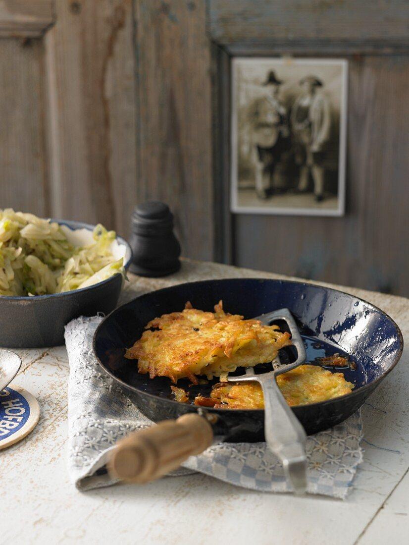 Potato pancakes with caraway cabbage (Bavaria)