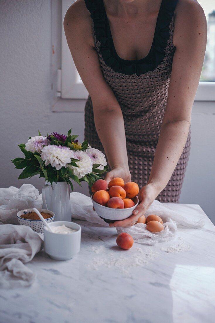 Woman baking an apricot yogurt cake