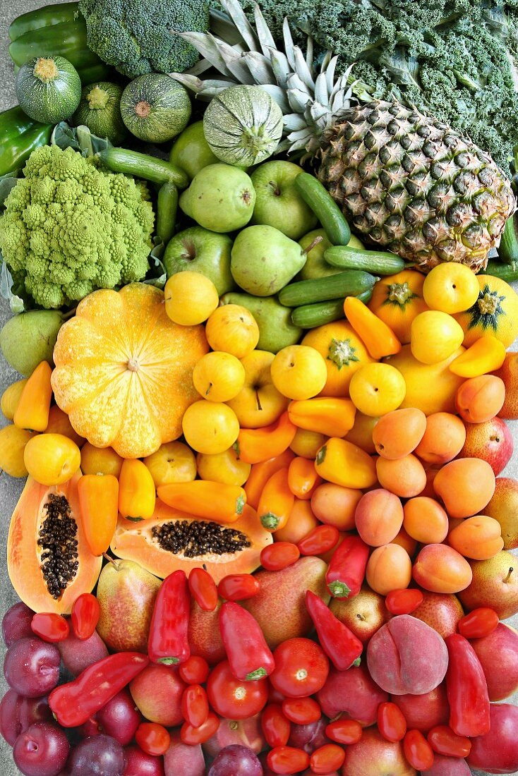Summer gradient fruit and vegetables on metal background