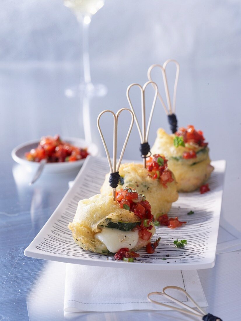 Baked courgette towers with cheese and pork in a crispy batter