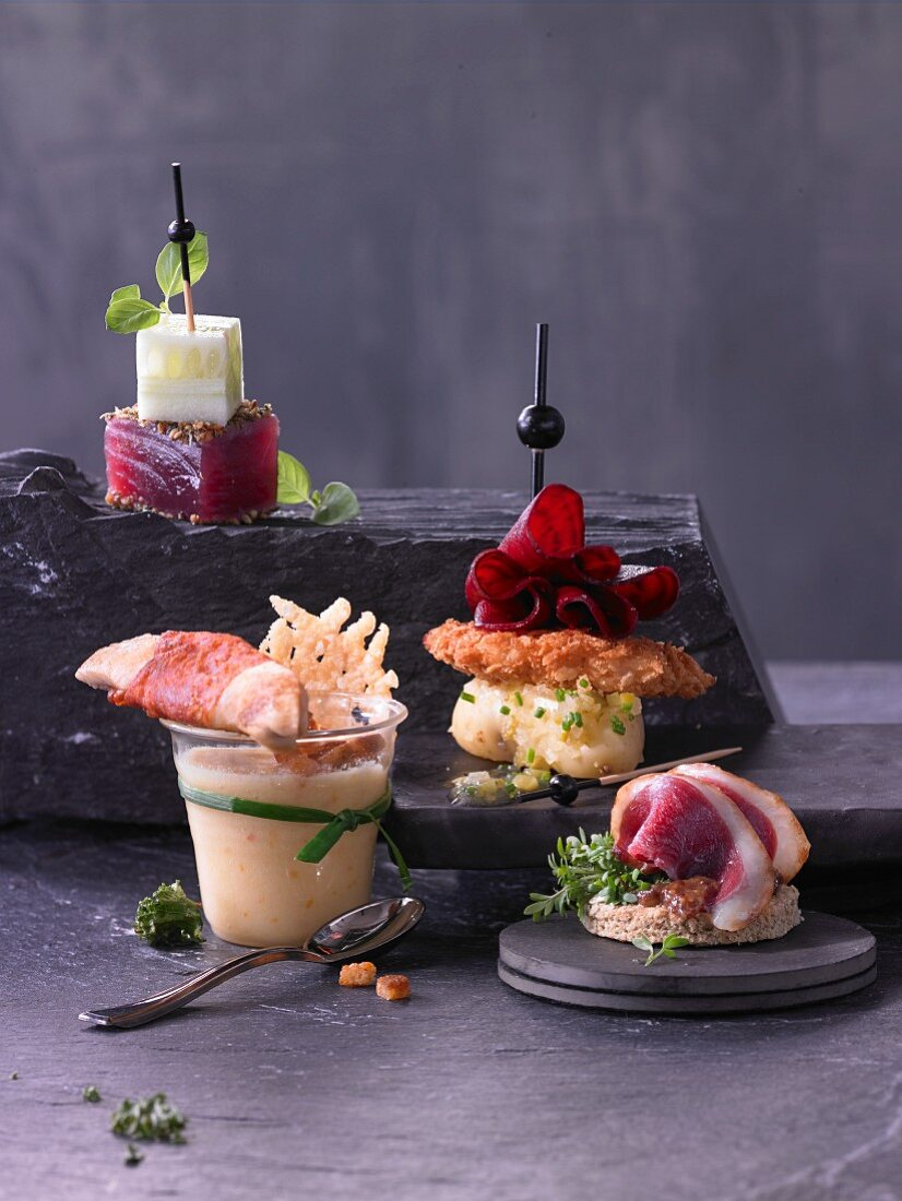 Various appetizers on a slate plate
