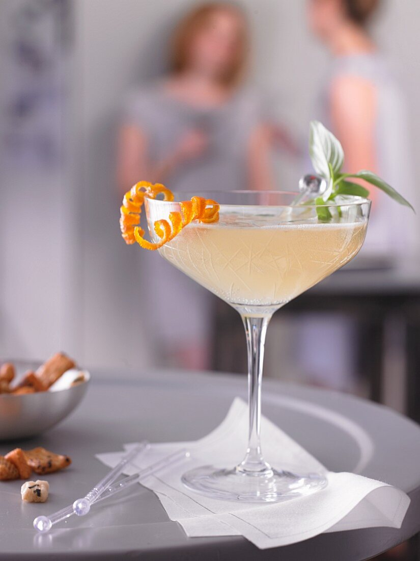 A cocktail with vodka, Thai basil, triple sec and sparkling wine
