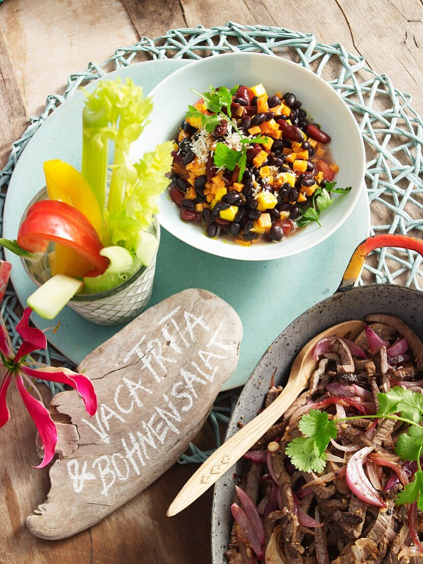 Vaca Frita (beef slices) and a mixed bean salad