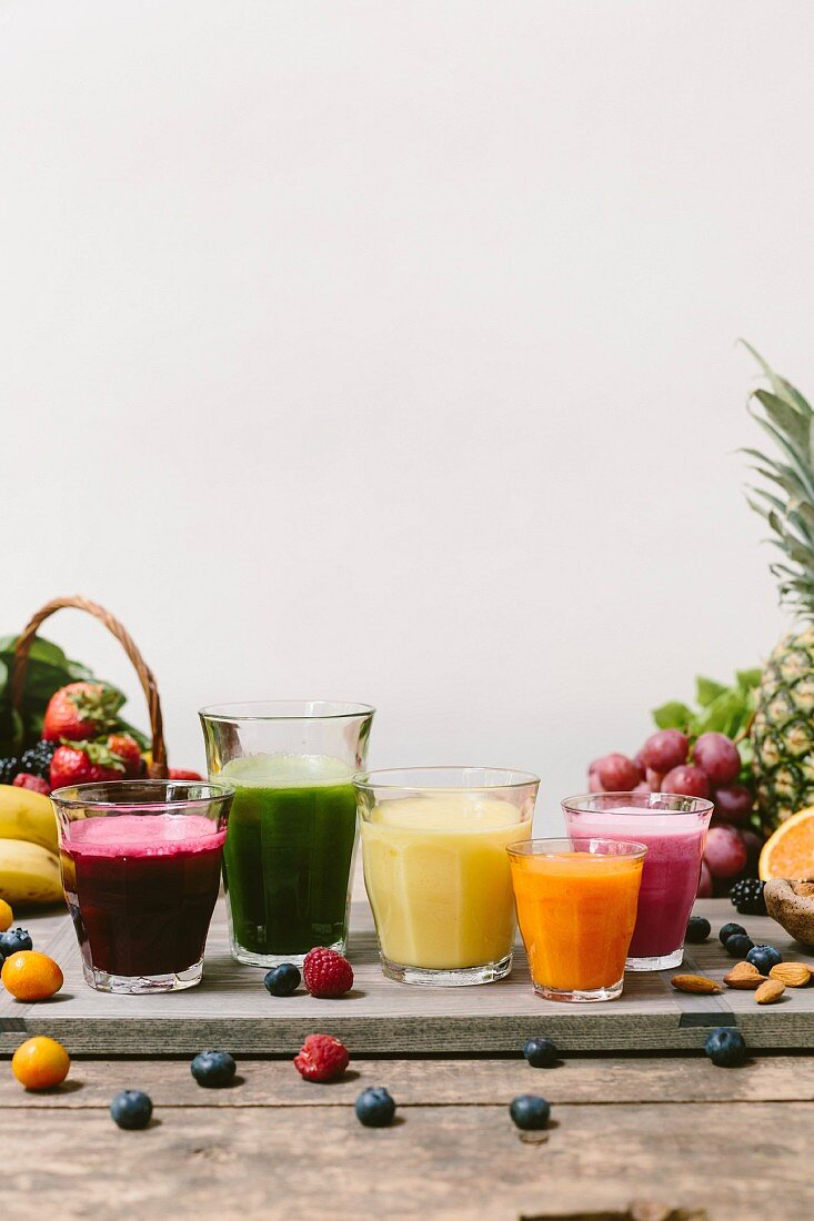 Five glasses of fresh smoothies (in all different colors)