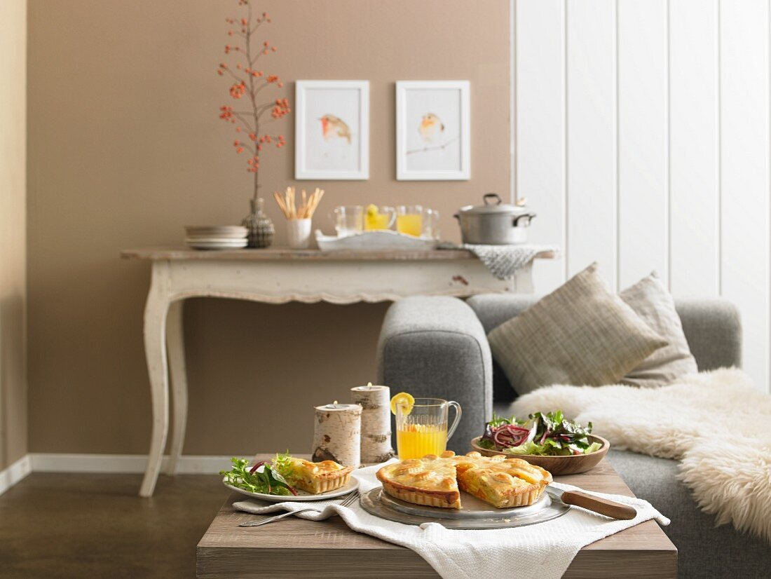 An autumn buffet with pumpkin and potato pie, salad and punch