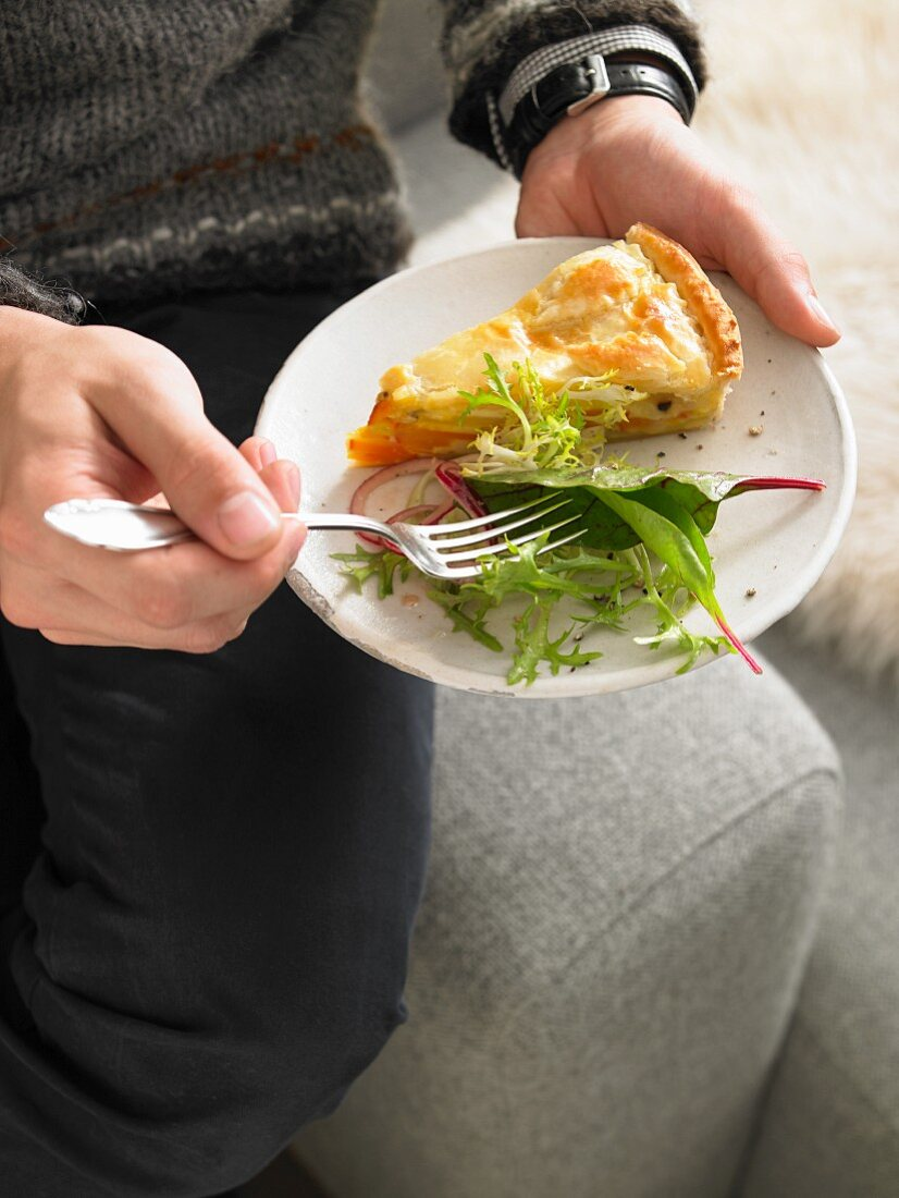 A slice of pumpkin and potato pie with lettuce