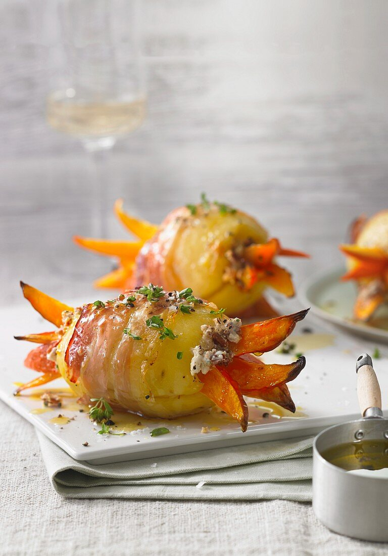 Potatoes wrapped in bacon with pumpkin strips