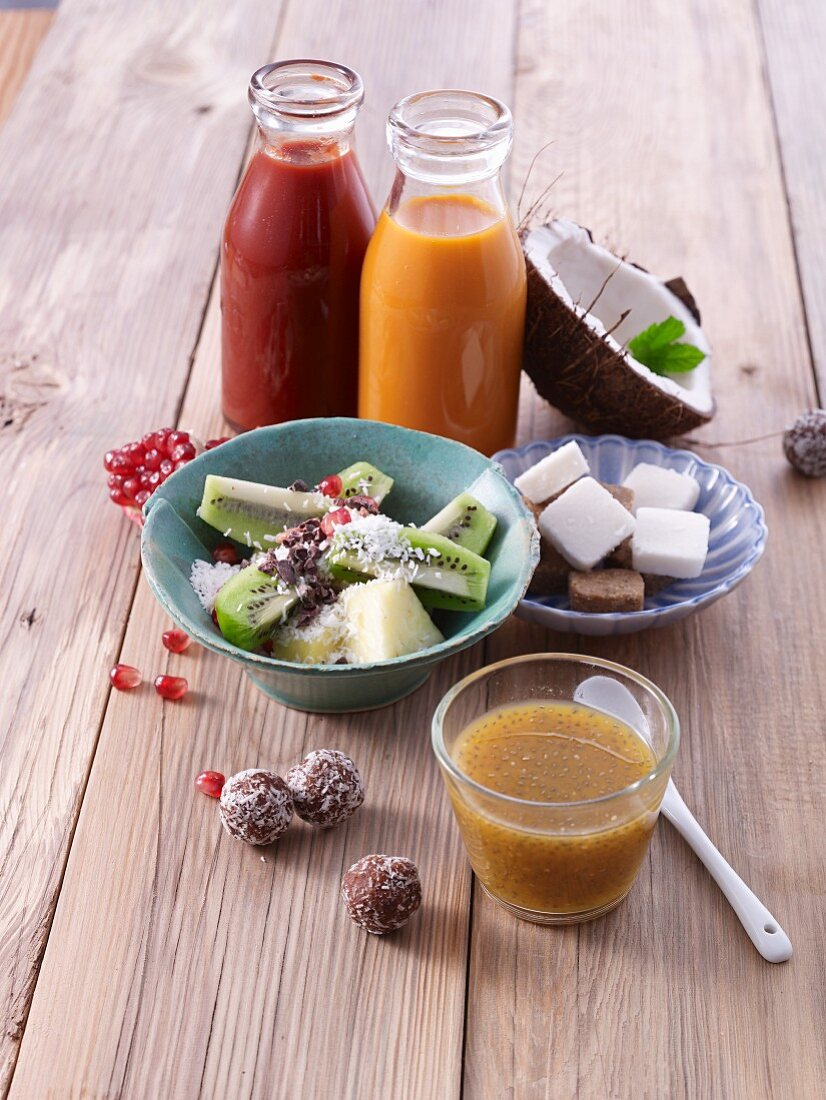 Smoothies with fruit salads and coconut balls