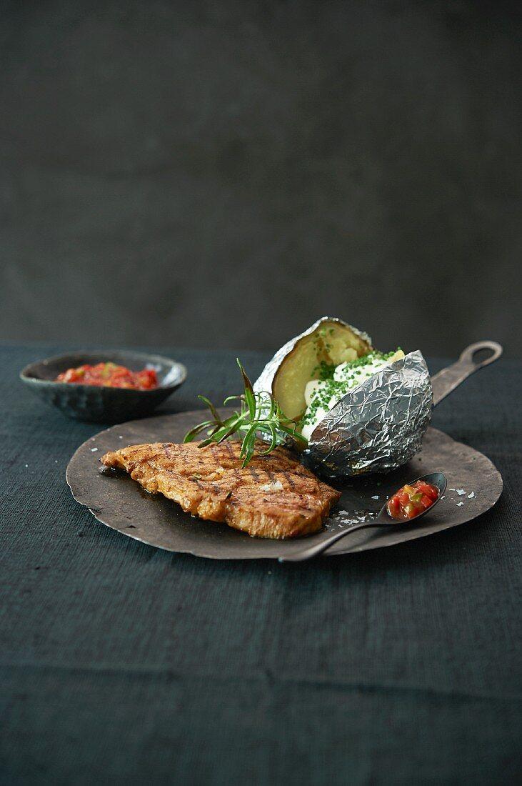 Pork steak with a potato in foil