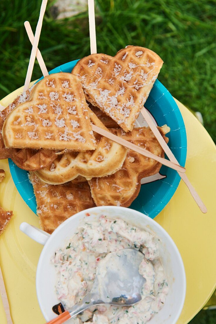 Heart shaped waffle lollies with a dip for a children's party in the garden