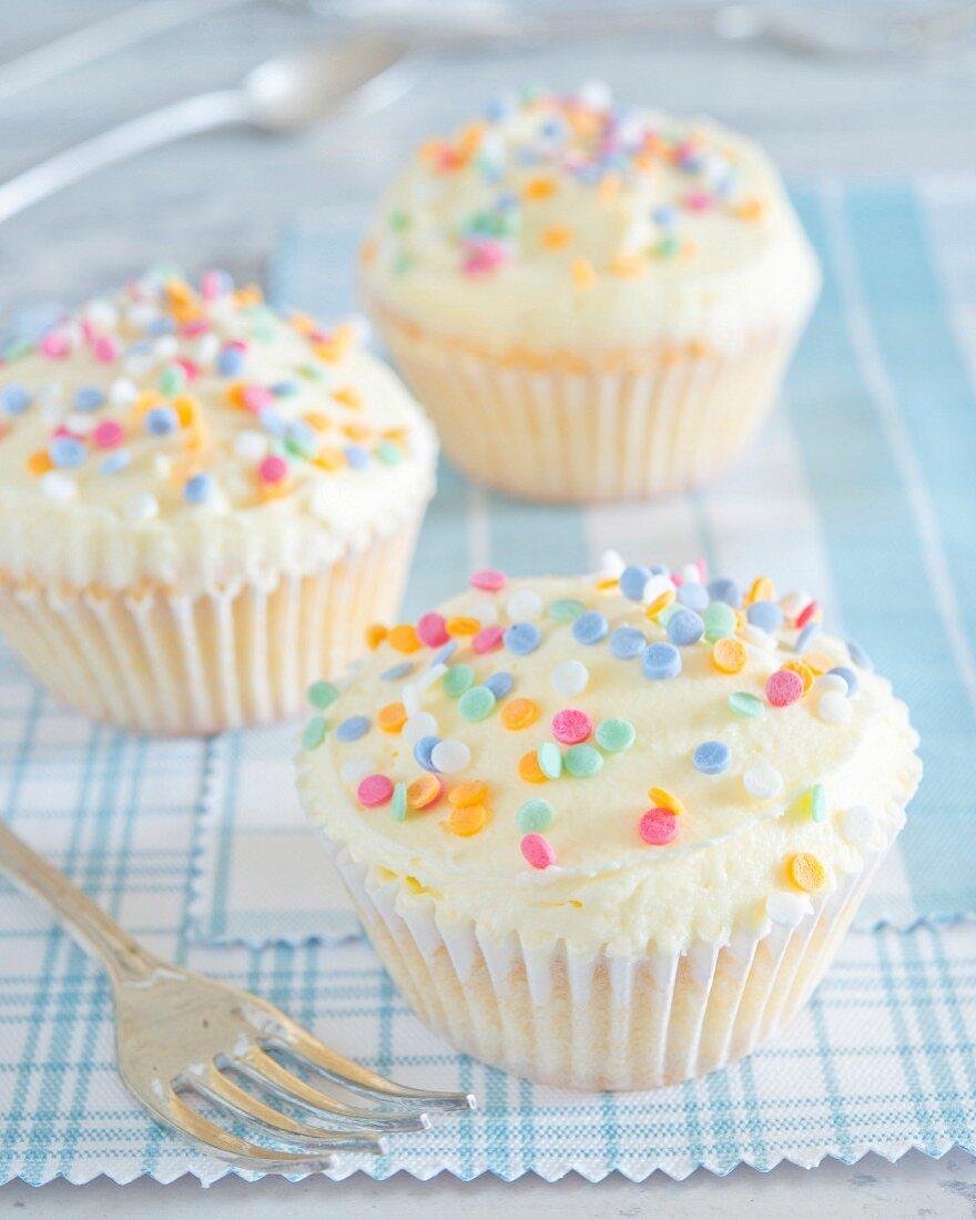 Cupcakes with buttercream and sugar confetti