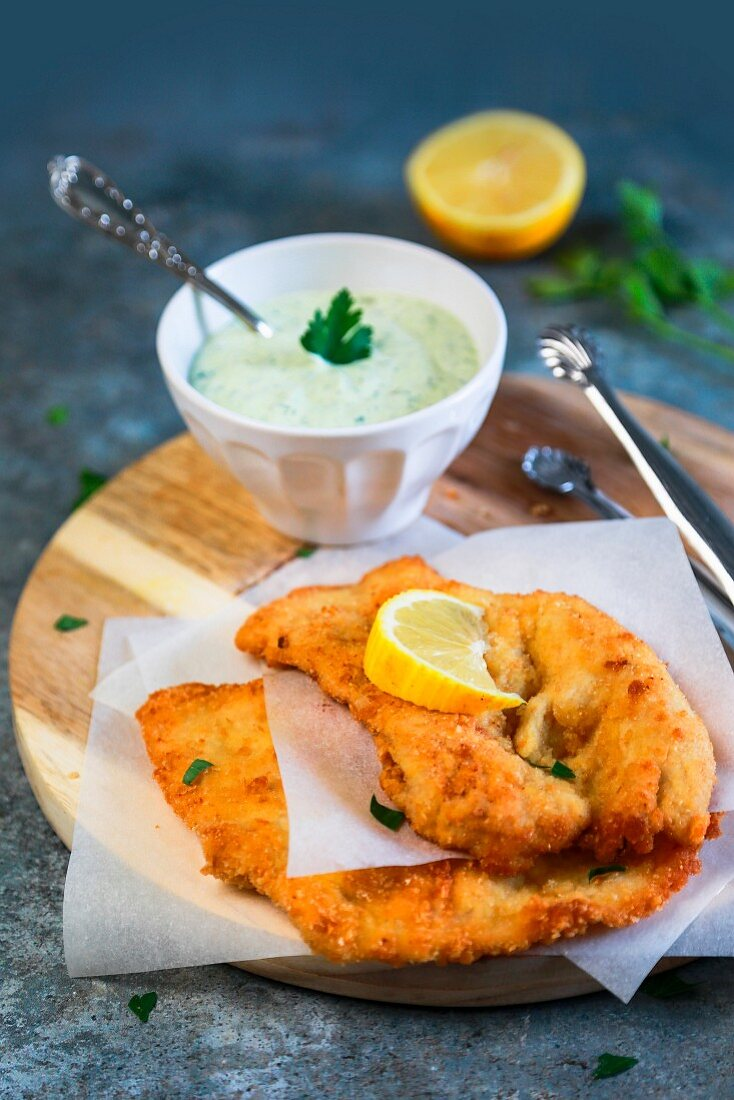 Lemon chicken cutlet with mayonnaise with yoghurt parsley and capers