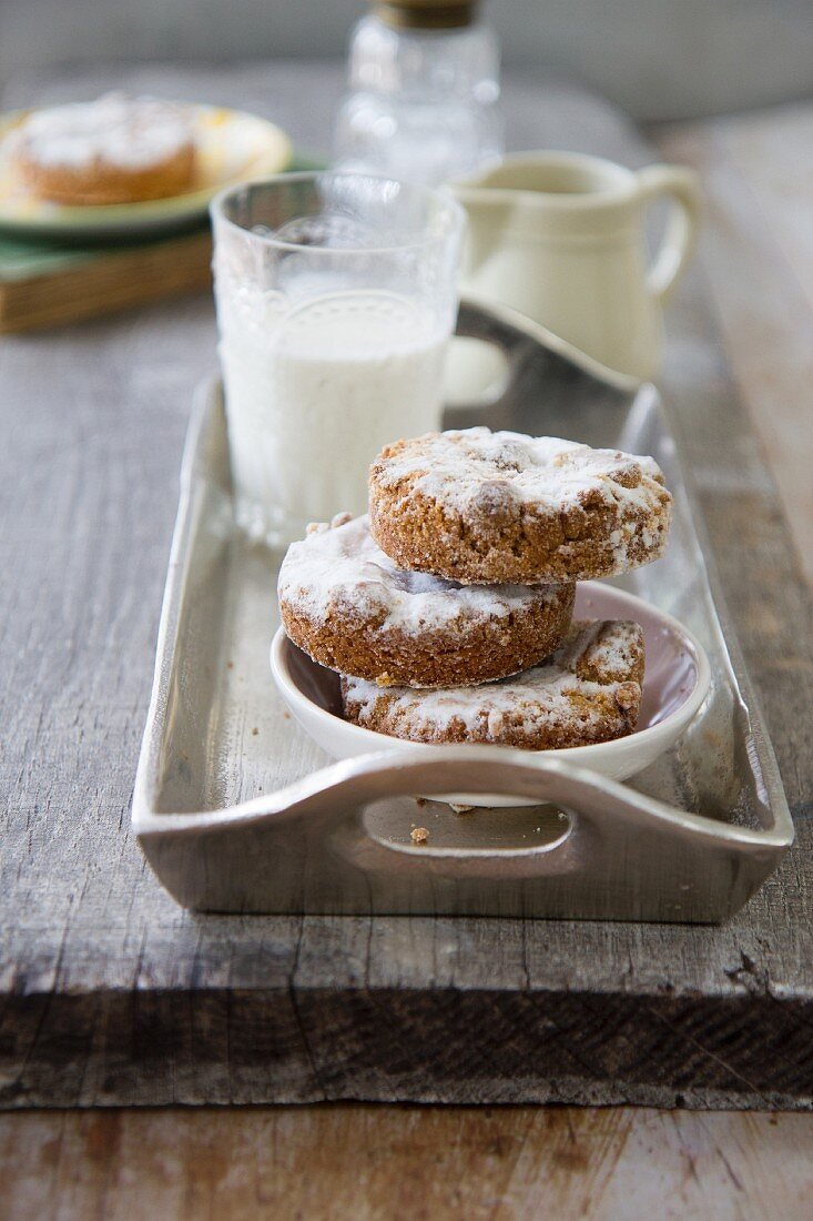 Almond cakes dusted with icing sugar