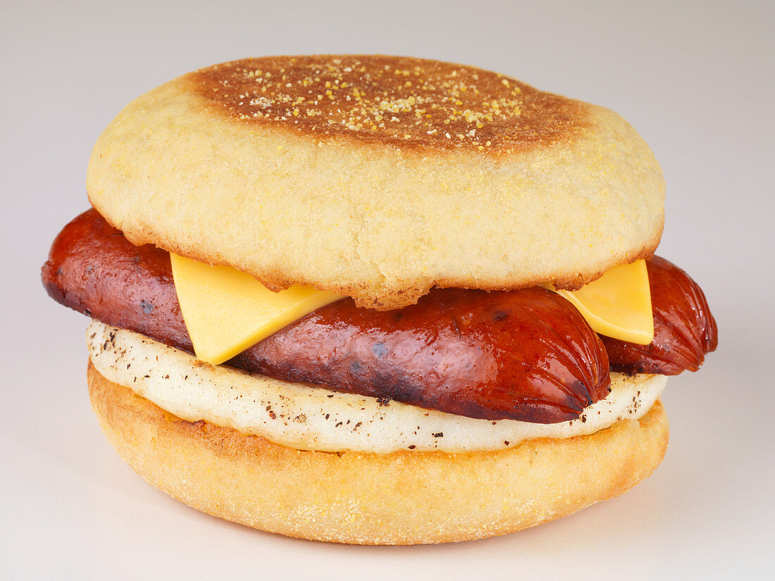 An English muffin with egg, sausage and cheese