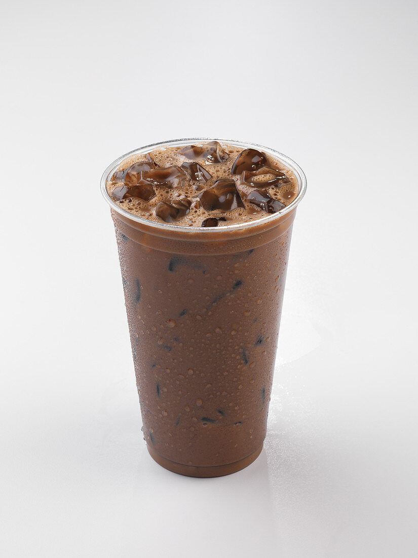 Iced Coffee in a Plastic Cup; Wrapped Straw