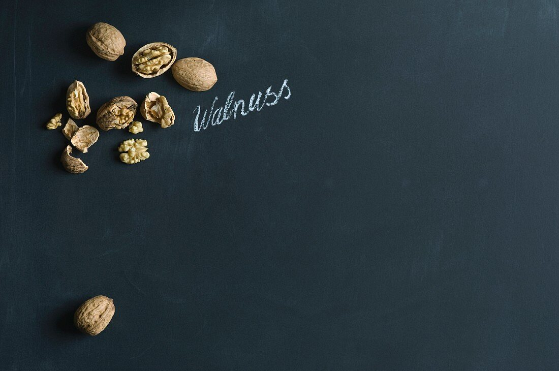 Walnuts (juglans regia), whole and shelled, with a handwritten label