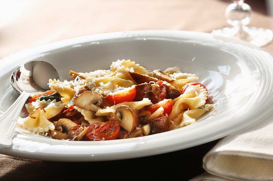 Farfalle with mushrooms, sausage and tomatoes