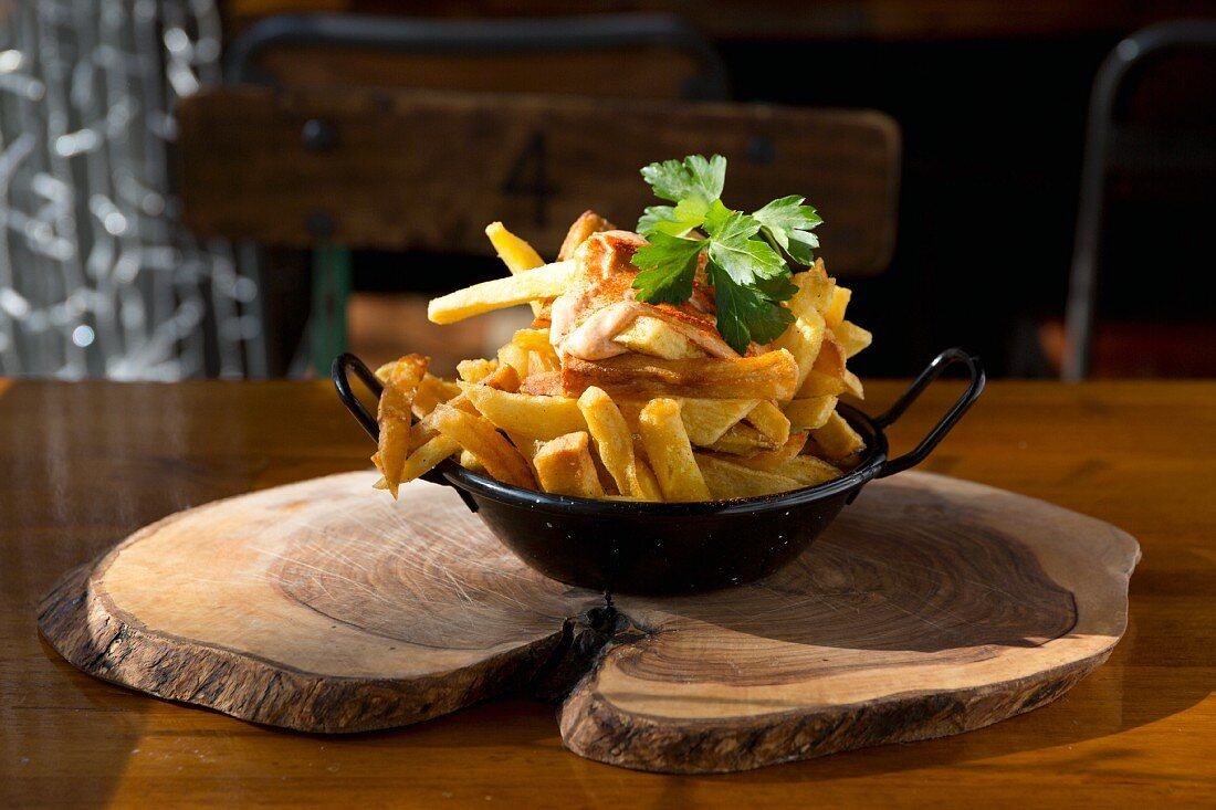 French fries in an iron pan