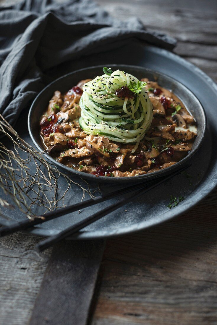 Vegan cucumber noodles with soya goulash and lingonberries