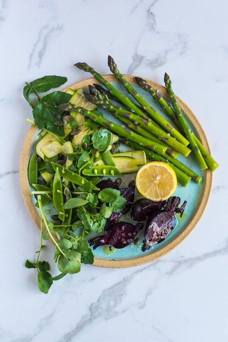 Asparagus and beetroot salad, sugar snap peas and lemon