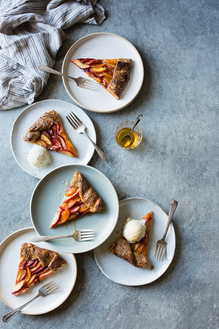 A galette with peach, nectarine and plum served with vanilla ice cream