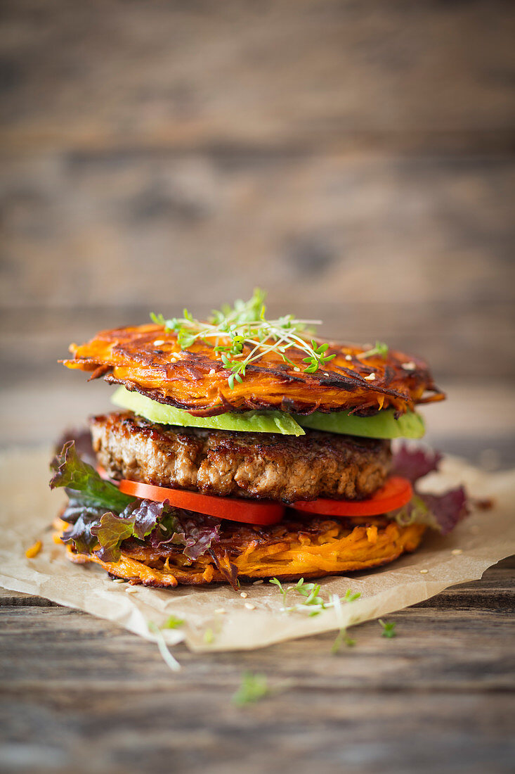 A hamburger with a sweet potato fritter bun