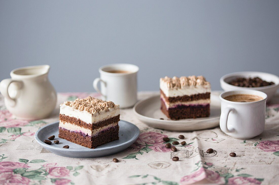 Cappuccino cake with chocolate sponge and vanilla frosting served with coffee