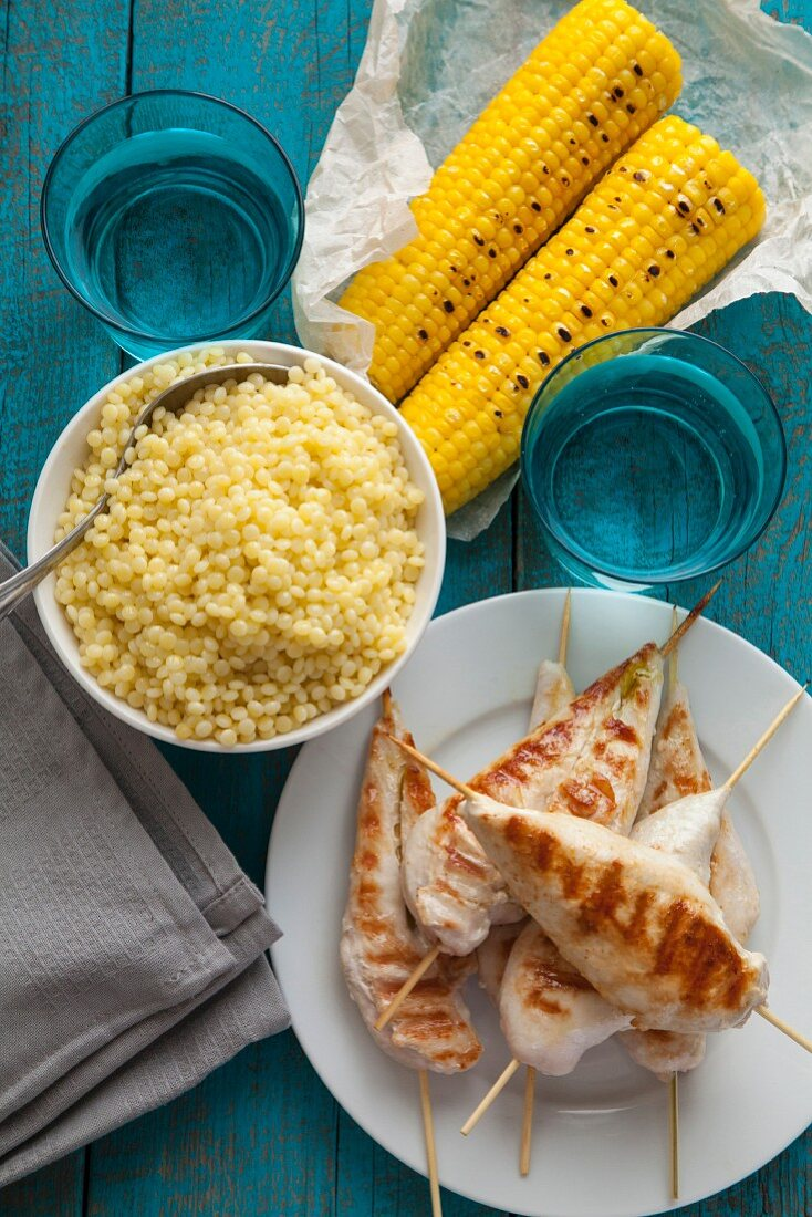 Grilled chicken with couscous and corn on the cob
