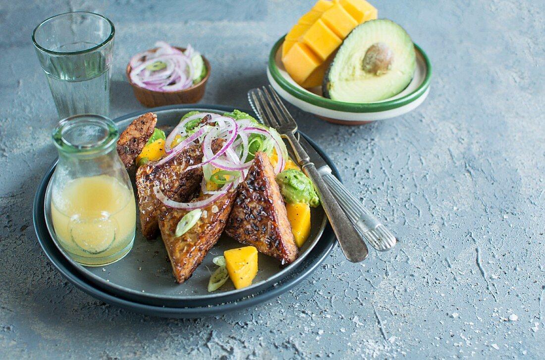 Avocado and mango salad with tempeh