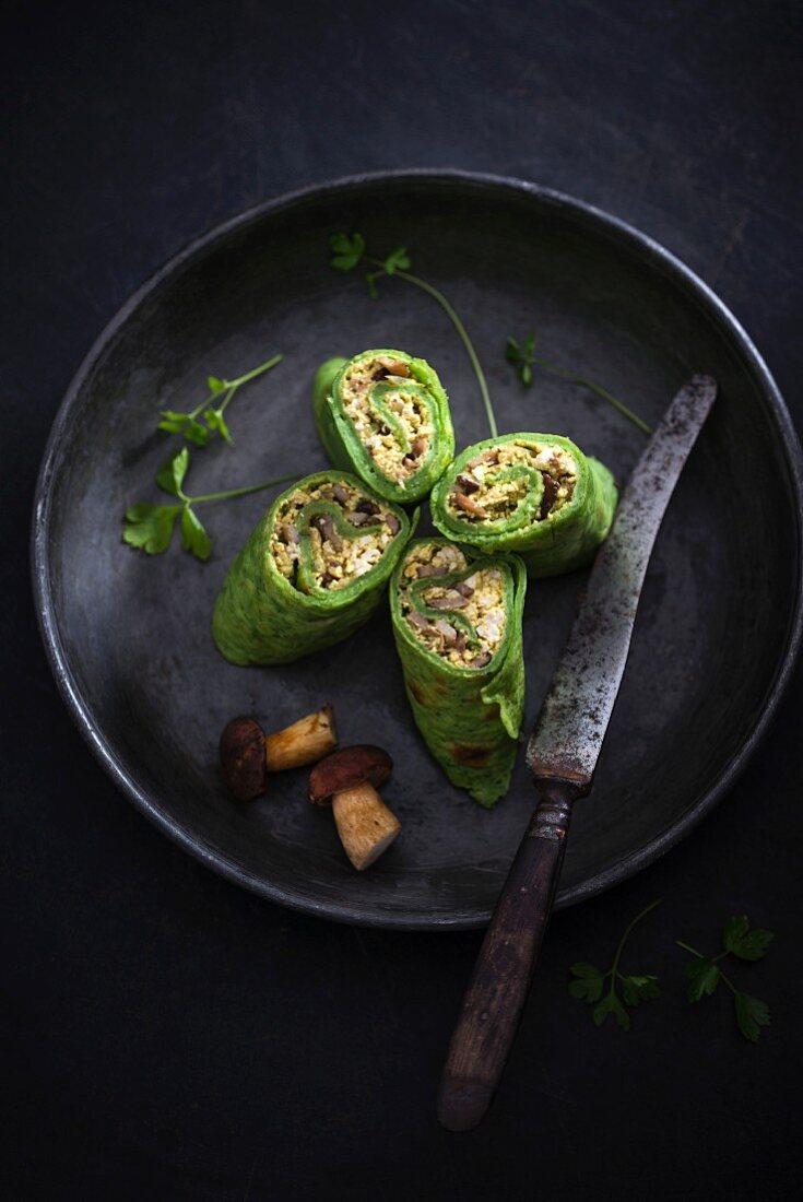 Vegan spinach pancake with scrambled tofu and wild mushroom filling